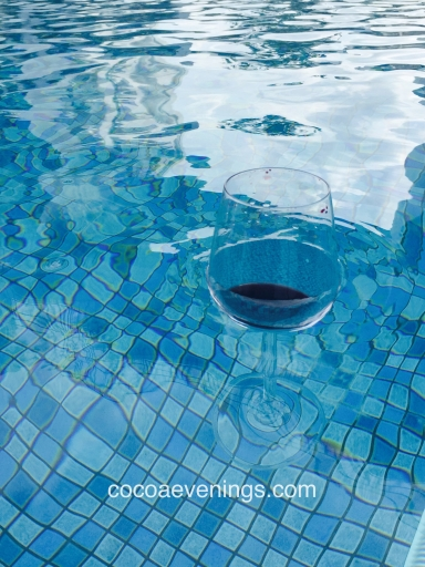 red-wine-crystal-glass-floating-water-swimming-pool